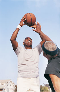 Older Men Playing Basketball
